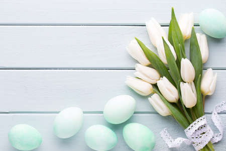 Mothers Day, womans day, easter, white tulips, presents on gray  background.