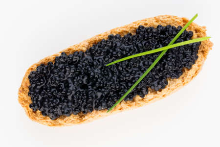 Sandwiches with caviar isolated on white background.