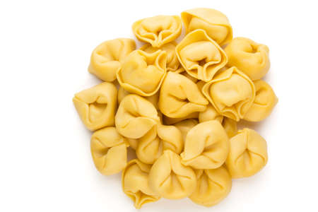 Raw homemade pasta,tortellini with herbs. Stock Photo