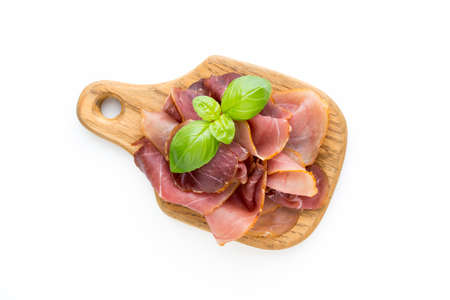 Italian prosciutto crudo or jamon. Raw ham. Isolated on white background Stock Photo