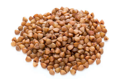 Buckwheat cereal grains isolated on the white background.