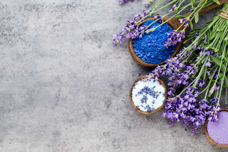 Essential lavender salt with flowers top view. Stock Photo