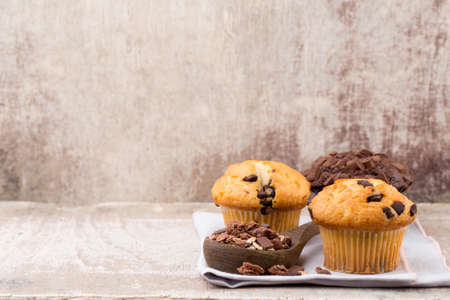Chocolate muffins with chocolate vintage background, selective focus.