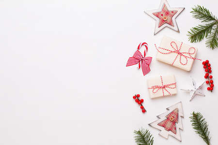 Christmas composition. Wooden decorations, stars on white background. Christmas, winter, new year concept. Flat lay, top view, copy space. 免版税图像