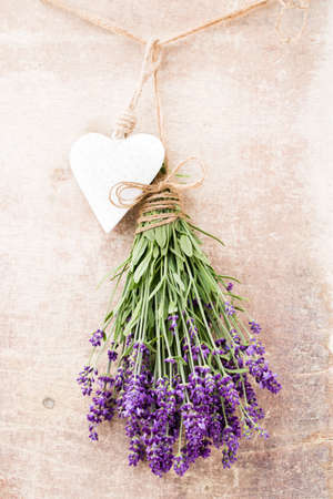Lavender flowers, bouquet on rustic background, overhead. Stock Photo