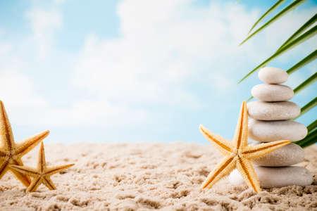 Stones spa treatment scene on the sea beach, zen like concepts.