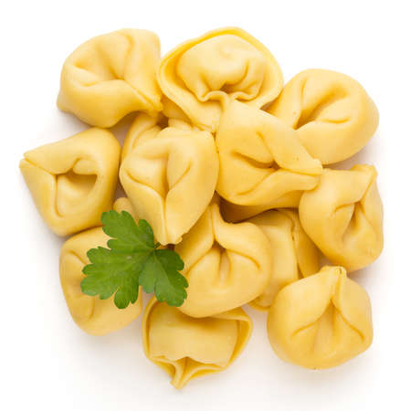 Raw homemade pasta,tortellini with herbs. 写真素材