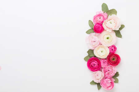 Beautiful colored ranunculus flowers on a white background. Valentines day greeting card. 免版税图像