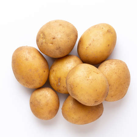 Potatoes isolated on white background. Flat lay. Top view. Banco de Imagens