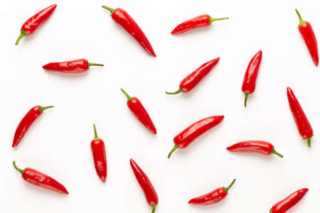 Chili or chilli cayenne pepper isolated on white background cutout. flat lay. Banco de Imagens