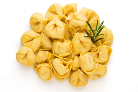 Raw homemade pasta, tortellini with herbs.