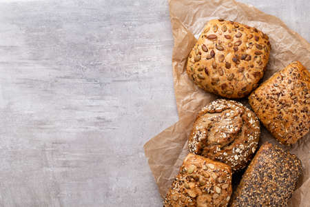 Bread background, top view of, black and rye loaves on black.