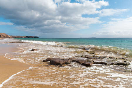 Panorama of beautiful beach and tropical sea of Lanzarote. Reklamní fotografie - 128801517