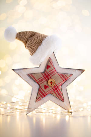 Christmas gold bokeh background with decorative star. Christmas gold stars. Reklamní fotografie - 128801636