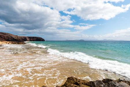 Panorama of beautiful beach and tropical sea of Lanzarote. Reklamní fotografie - 128801671