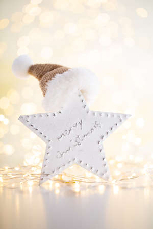 Christmas gold bokeh background with decorative star.