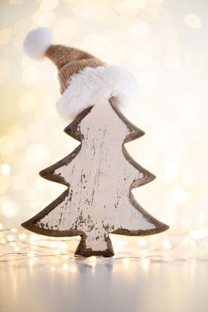 Christmas gold bokeh background with decorative tree.