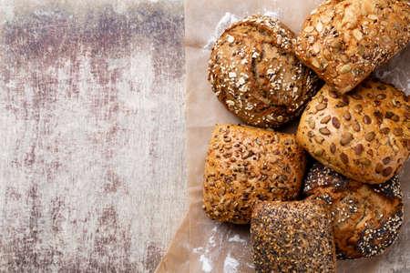 Freshly baked bread on dark gray kitchen table, top view. Reklamní fotografie