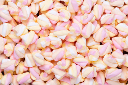 Colorful marshmallows background. Top view. Flat lay.