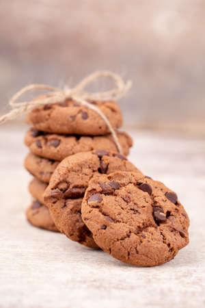 Freshly baked chocolate chip cookies on rustic wooden table Reklamní fotografie