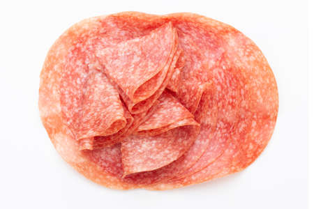 Salami smoked sausage slices isolated on white background Reklamní fotografie