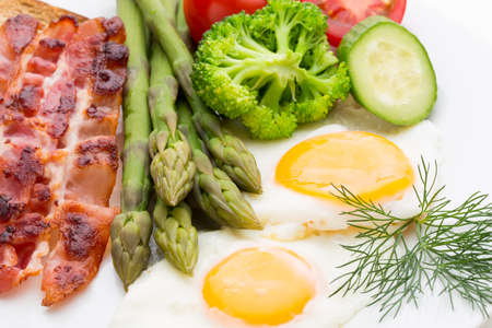 Two fried eggs and bacon for healthy breakfast . selective focus Reklamní fotografie - 128677072