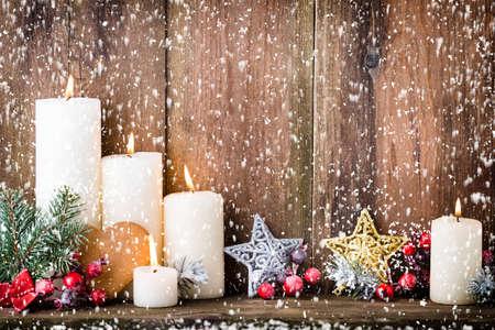 Christmas Advent candles with festive decor. Stock fotó