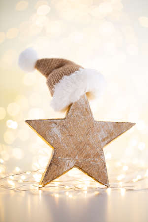 Christmas gold bokeh background with decorative star. Christmas gold stars.