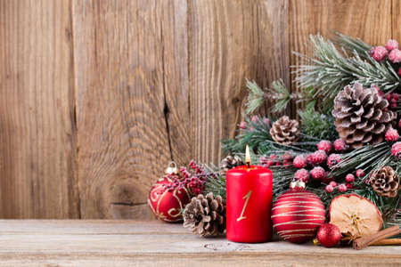 Christmas greeting card. Festive decoration on wooden background. New Year concept. Copy space.  Flat lay. Top view. Stockfoto