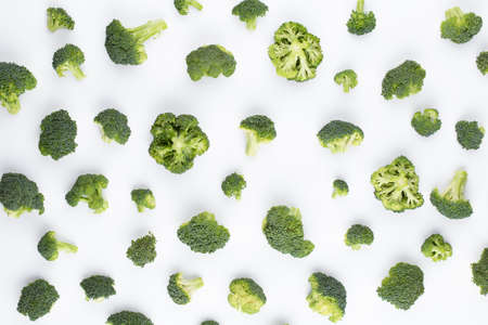 Broccoli pattern isolated on a white background. Various multiple parts of broccoli flower. Top view. Reklamní fotografie