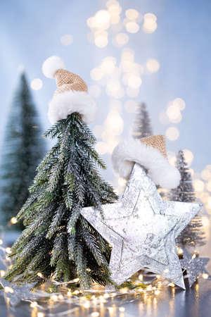 Christmas tree on blue bokeh background. Reklamní fotografie