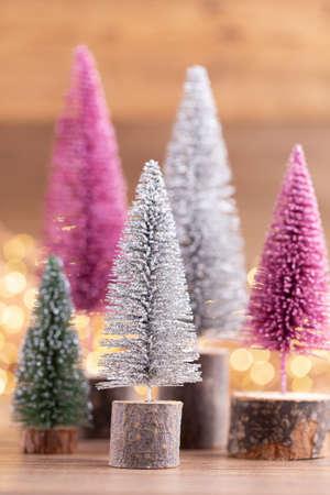 Colorful Christmas tree on bokeh background. Christmas holiday celebration concept. Greeting card.
