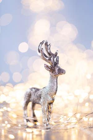Christmas decor on blue bokeh background.