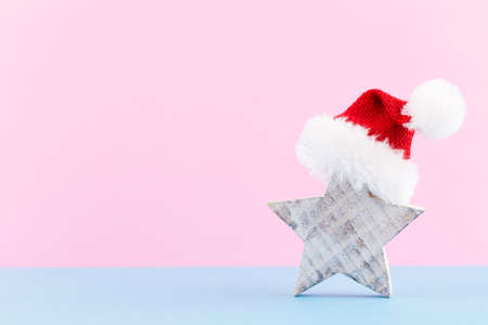 Christmas star, decor on pastel colored background. Christmas or New Year minimal concept. Reklamní fotografie