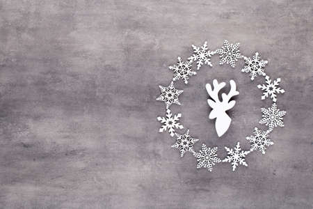 Christmas composition. White snow flakes wreath decorations on gray background. Christmas, winter, new year concept. Flat lay, top view, copy. Reklamní fotografie