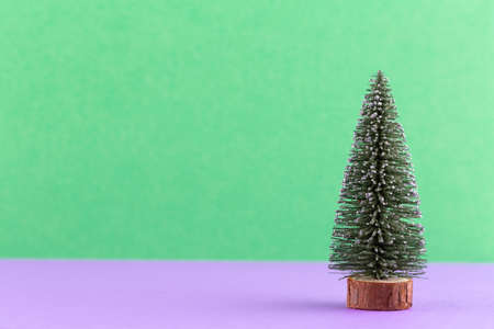 Christmas tree on pastel colored background. Christmas or New Year minimal concept. Reklamní fotografie