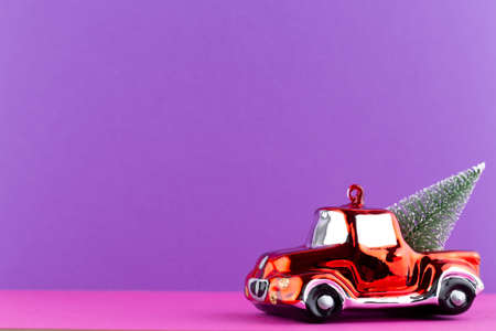 Christmas car on pastel color background. Christmas or New Year minimal concept. Reklamní fotografie