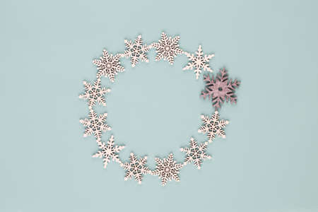 Christmas composition. Christmas wreath on blue background. Flat lay, top view, copy space