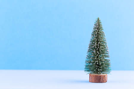 Christmas tree on pastel colored background. Christmas or New Year minimal concept. Stock Photo