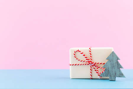 Christmas gift boxes on pastel background.