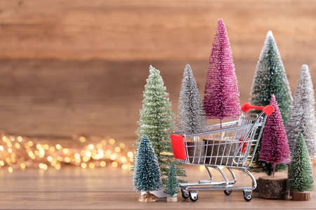 Colorful Christmas tree on wooden, bokeh background. Christmas holiday celebration concept. Greeting card.