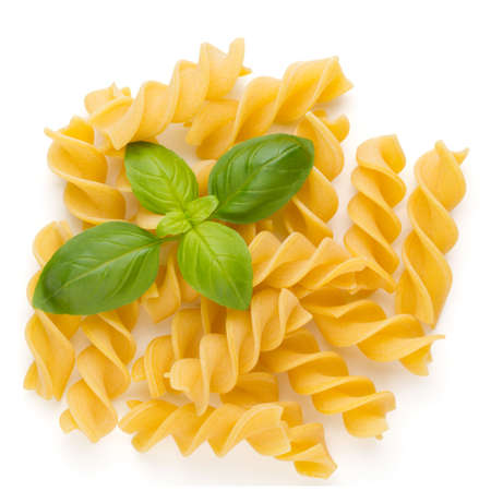 Raw uncooked pasta penne on the white background.