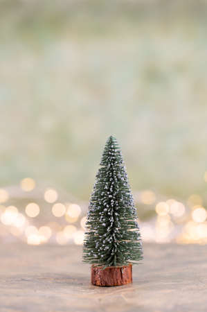 Colorful Christmas tree on green, bokeh background. Standard-Bild - 130129830