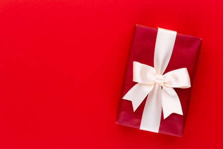 Christmas gift boxes with ribbons on color tabletop.