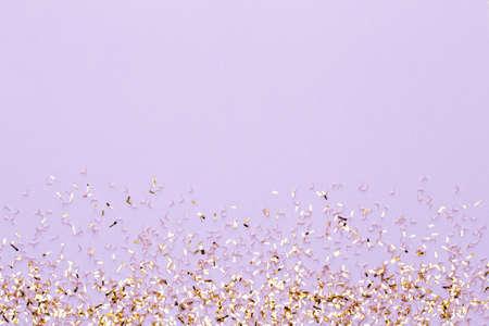 Festive pastel background. Christmas stars and shining glitter, confetti on pastel background. Christmas. Wedding. Birthday. Valentines Day. Flat lay.