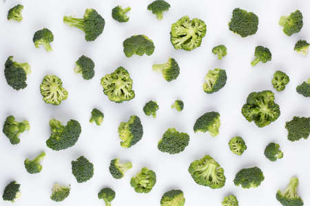 Broccoli pattern isolated on a white background. Various multiple parts of broccoli flower. Top view. 写真素材
