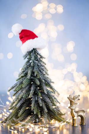 Christmas tree on blue bokeh background. Banco de Imagens