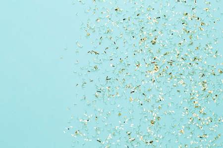 Christmas stars and shining glitter, confetti on pastel