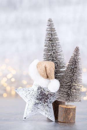 Christmas tree on silver, bokeh background. Banco de Imagens