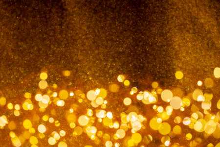 Christmas and Happy new year on blurred gold bokeh banner Banco de Imagens